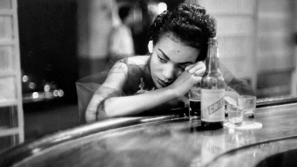 """Bar Girl in a Brothel in the Red Light District, Cuba, Havana"" by Eve Arnold"
